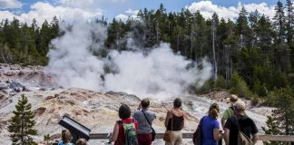 Erupting Steamboat Geyser At Yellowstone National Park